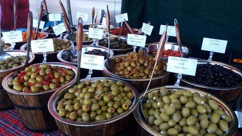 Market trader selling olives