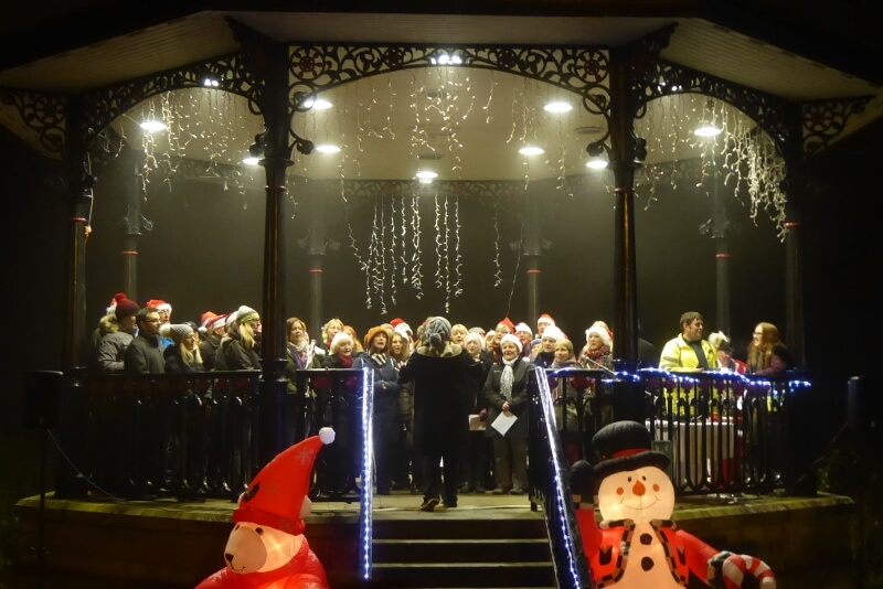 Buxton Studio Choir on the Bandstand at the Winter Lights Switch On. Image courtesy of Ali Quas-Cohen.
