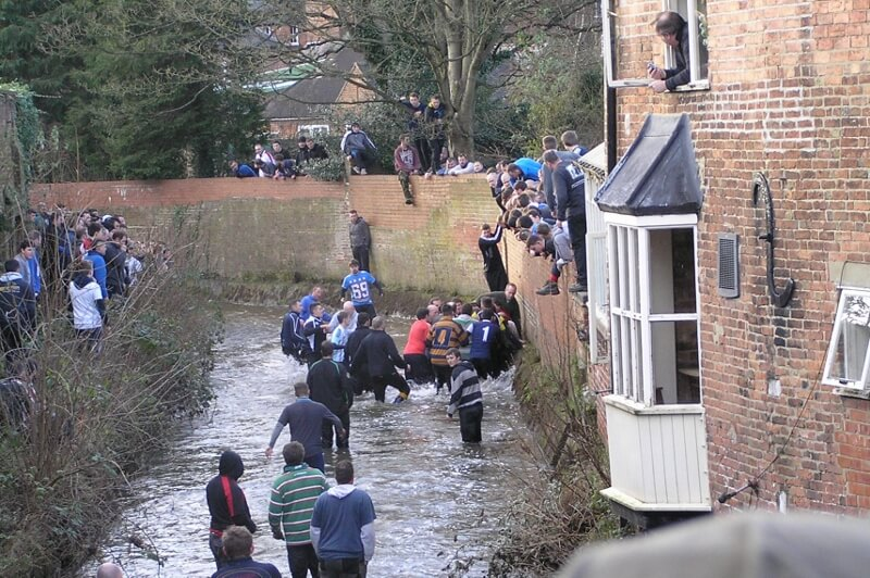 Shrovetide Football at Ashbourne in Henmoor Brook. Image courtesy of Ali Quas-Cohen.
